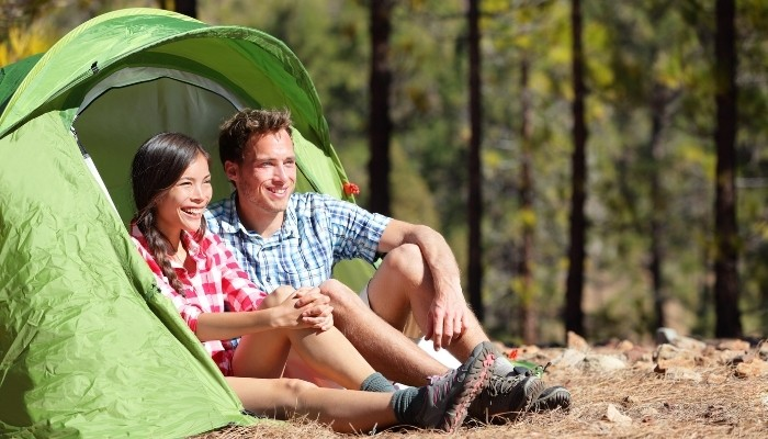 Couple Camping In Green Tent