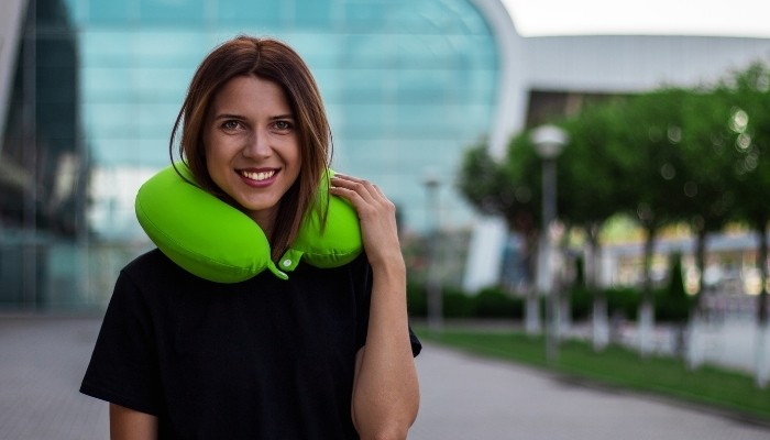 Girl With Green Travel Pillow
